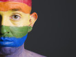 Face man painted with gay flag