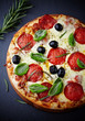 Pizza with salami and herbs on chalk background