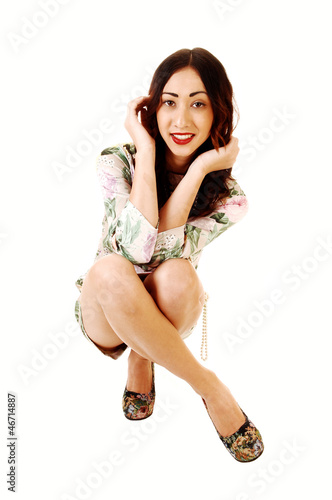Woman crouching on floor.