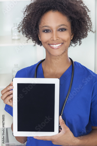 African American Female Doctor With Tablet Computer
