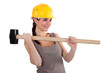 A female construction worker with a sledgehammer.