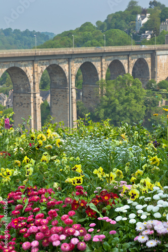Bright Flowerbed and tall stone bridge