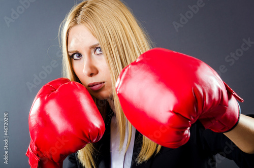Woman boxer in dark room