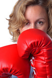Woman wearing boxing gloves close up