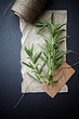 Fresh rosemary sprigs and kitchen twine on chalkboard