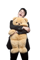 happy smiling businessman embracing big soft toy