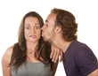 Man Kissing Surprised Woman