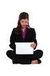Businesswoman sat barefoot with laptop