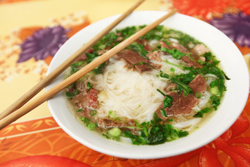 Traditional Vietnamese soup Pho with rice noodles and meat