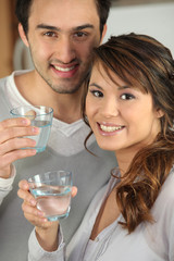 Couple drinking glasses of water