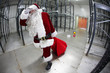 Tired Santa Claus loosing gifts from red sack
