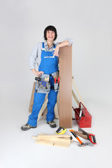 Woman about to lay laminate flooring