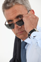 Older businessman wearing sunglasses