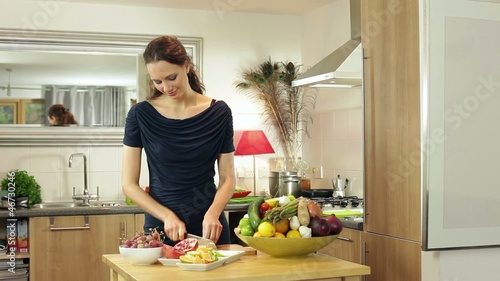 Happy couple in kitchen preparing meal