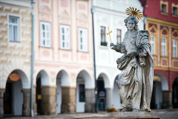 Statue on fountain at the main square of Telc, Czech republic