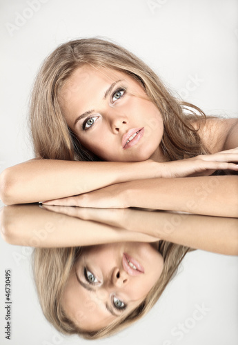 Beautiful girl with a mirror