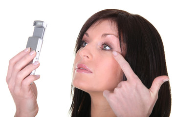 Brunette woman looking at mobile phone screen