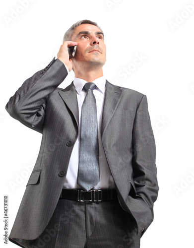 Portrait of Caucasian business man using phone