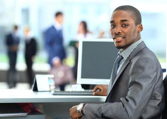 African American entrepreneur displaying computer