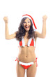 surprised christmas woman wearing a santa hat smiling