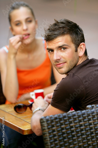 Couple having a coffee on terrace