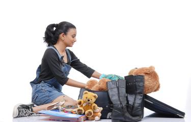 Girl packing her travel bag