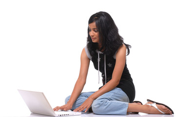 Indian pretty Girl working on laptop