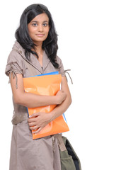 Girl holding folders and documents