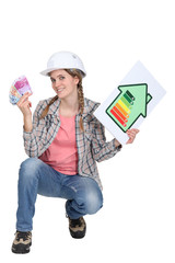 Female builder holding cash