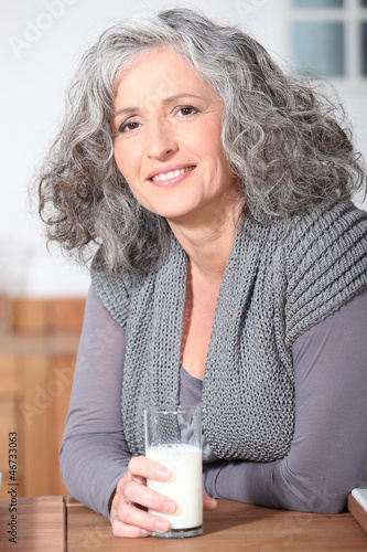 Older woman with a glass of milk