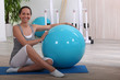 Woman with an exercise ball