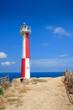 Lighthouse on the blue sky background