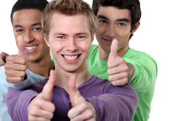 Three teenagers giving the thumbs-up