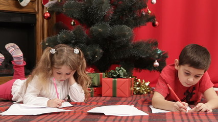 Brother and sister writing a letter to Santa