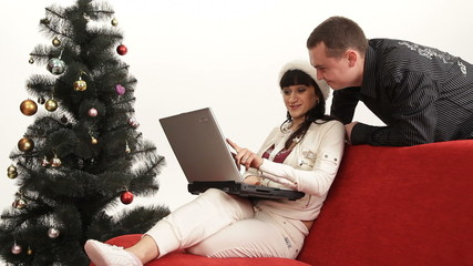 Couple shopping on the internet for winter holidays