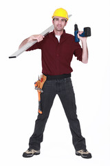 Worker with a cordless power drill