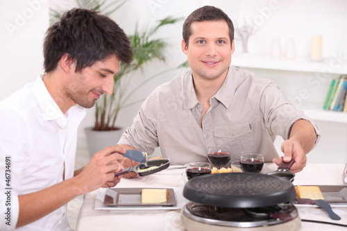 Two men enjoying a Raclette