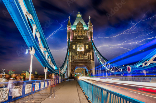 Light trails in Tower Bridge Road at night with storm
