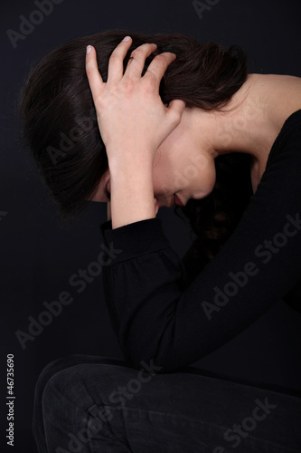Woman holding head