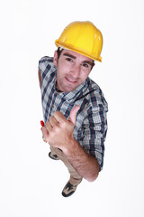 Manual worker giving the thumb up.