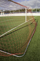 Red goal on grass