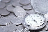 Pocket watch on silver coins, close up
