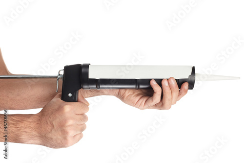 Caulking gun tool and hands on white with clipping path