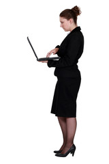 Profile shot of brunette with laptop