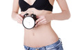 Beautiful fit woman with clock on belly