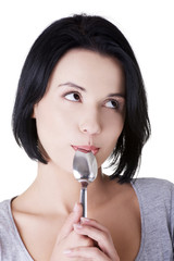 Woman with spoon in her mouth