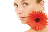 Young lady with red gerbera isolated on white background
