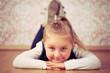 beautiful little girl lying on floor
