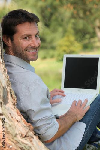 Happy man sitting outdoors