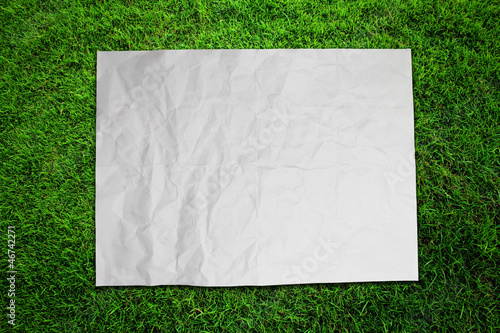 Paper on green grass field